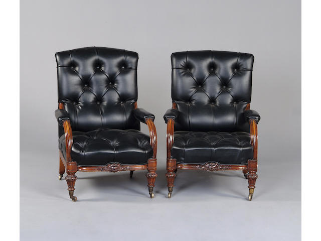 A pair of Victorian walnut framed armchairs