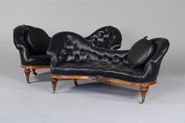 A pair of Victorian walnut framed settees