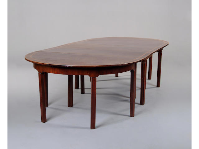 A mahogany and satinwood crossbanded D-end extending dining table