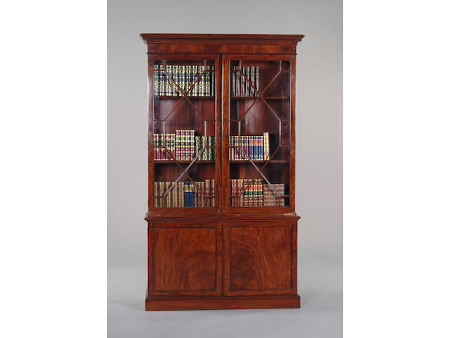 A George III style mahogany cabinet bookcase.
