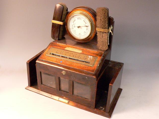 An early 20th century oak post box