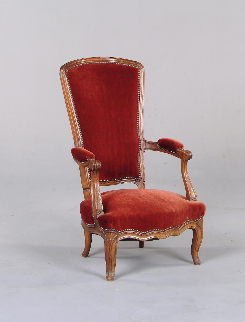 A Louis XV style carved beechwood open armchair