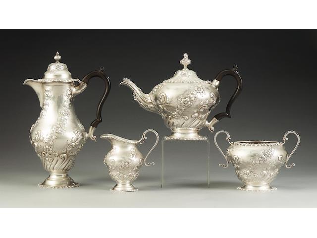 An Edwardian silver four piece tea and coffee service, by Sharman Dermott Neill, London 1903, incuse retail mark S. D. NEIL, BELFAST,