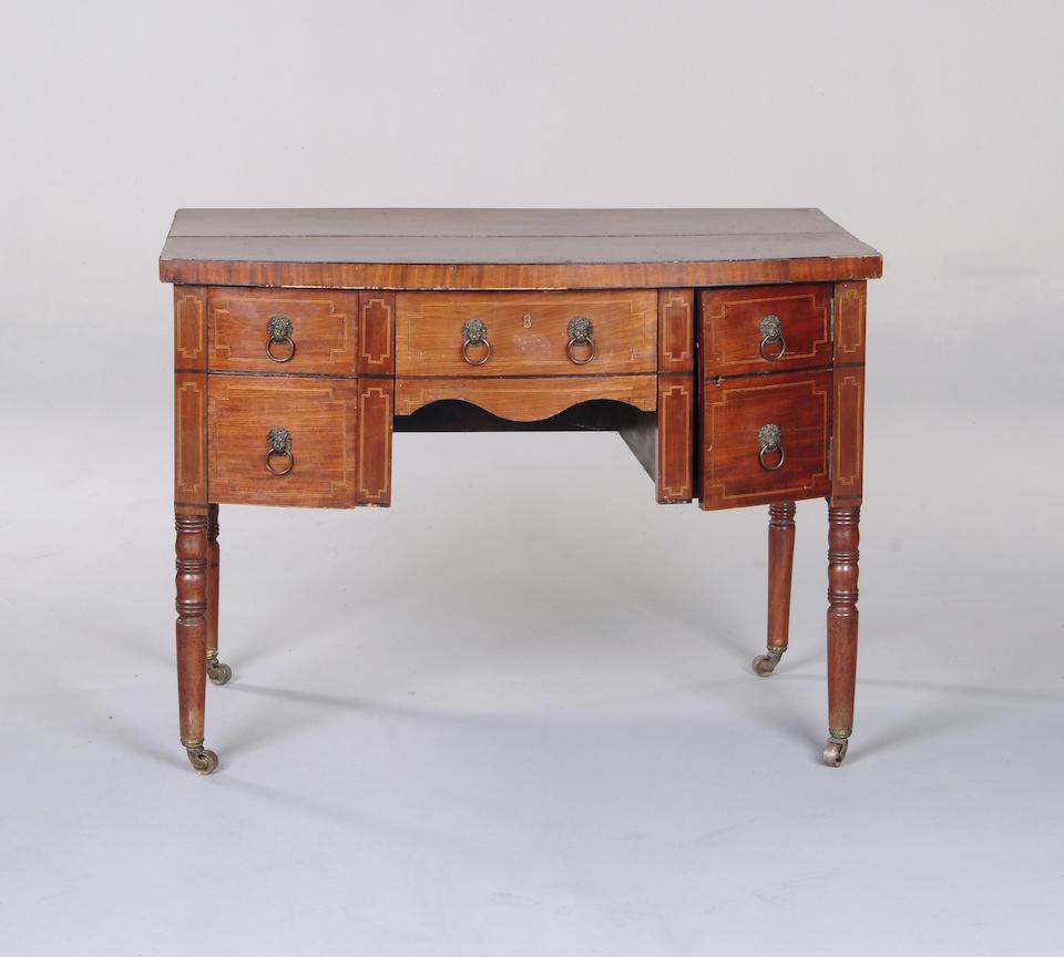 A mahogany bowfront dressing table
