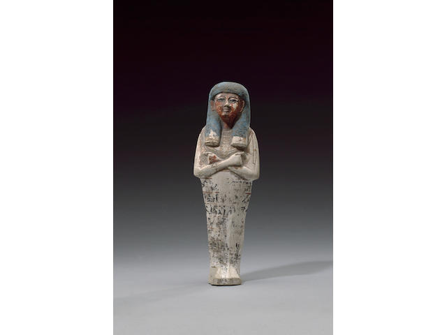 A sizeable Egyptian polychrome painted limestone shabti