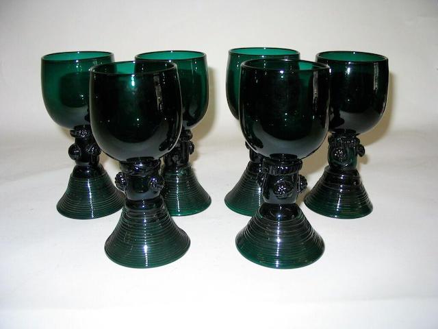 Seven green glass roemer type wine glasses