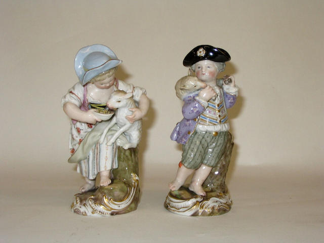 A pair of Meissen figures of a shepherd and shepherdess