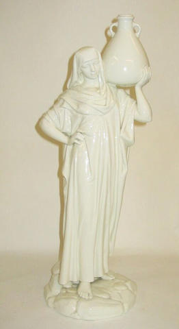 A Royal Worcester figure of an Eastern Water Carrier