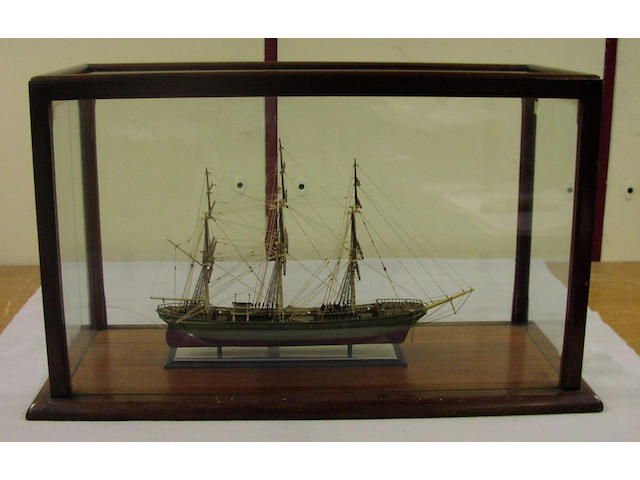 A small cased model of a three mast sailing ship, 67 x 30x 38cm.