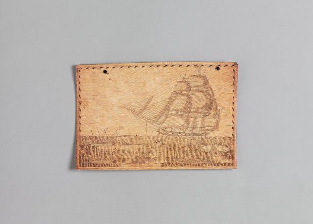 A fine scrimshawed panbone, mid 19th century, 6.75x10.25in(17x26cm)