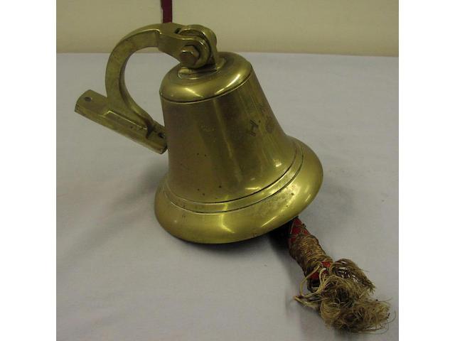 A brass ship's bell, 23 x 23cm.