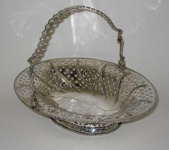 A George III swing handled cake basket By William Plummer, 1760,