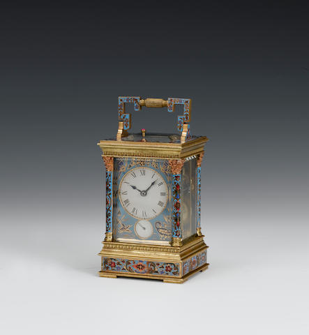 A late 19th century petite sonnerie striking carriage alarm clock with champleve enamel decorated case