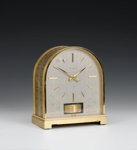 A 20th century lacquered brass and engraved Atmos timepiece  Jaeger Le Coultre