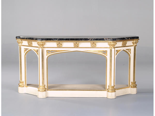 A George IV later cream painted and parcel gilt console table, in the manner of Morel and Seddon, after designs by Pugin