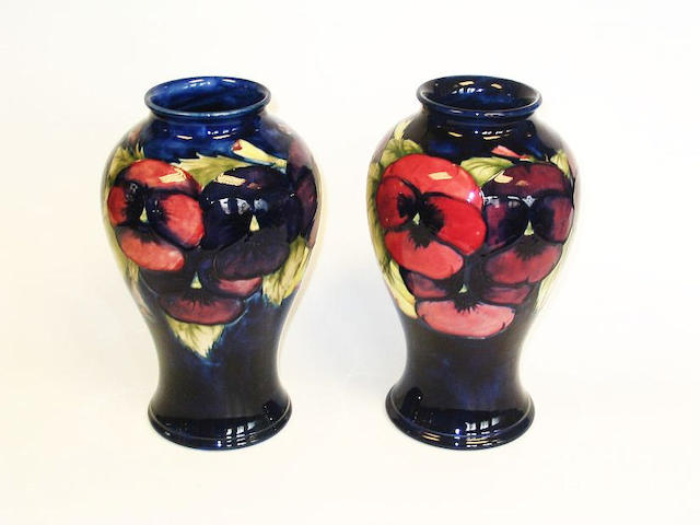 a pair of Moorcroft 'Pansy' vases