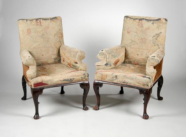 A near pair of mahogany armchairs,