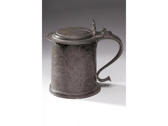 A fine Charles II wriggle-work flat lidded tankard,
