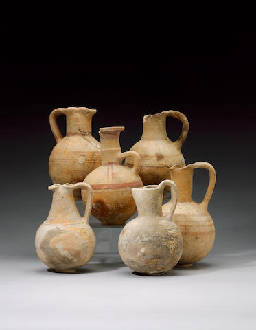 Six Cypro-Phoenician buff pottery jugs and oinochoai 6