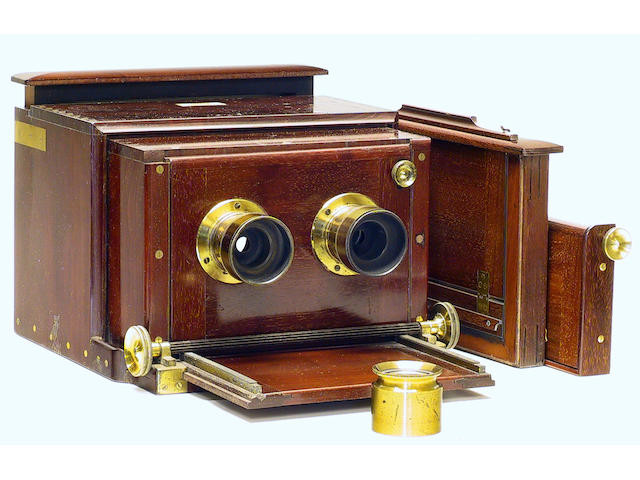 Dallmeyer Stereo Sliding Box camera The classic 1860's stereo sliding box No. 374, for 7 x 4 inches (18 x 10cm) pictures. Complete with one original wet collodion dark slide and the focusing screen.   Stereo pair of Dallmeyer  lenses Nos. 7108 and 7206 with provision for Waterhouse stops. Finely dovetailed dark mahogany and brass, rising/ drop front, focusing magnifier and beautifully made replica detachable flap shutter.  (6)