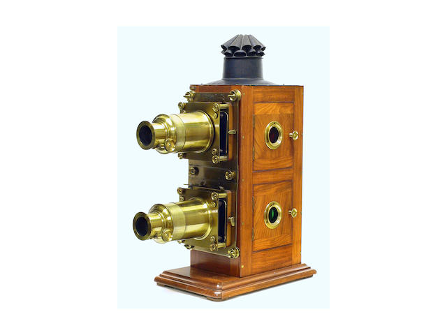 "Walter Tyler Bi-Unial Magic Lantern, English, circa 1880, fine lacquered, mahogany body with double brass bound lenses, rack and pinion focusing, signed ""Walter Tyler manufacturers 115 Waterloo Road London""."