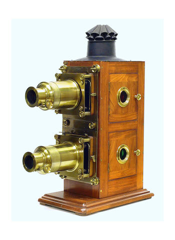 """Walter Tyler Bi-Unial Magic Lantern, English, circa 1880, fine lacquered, mahogany body with double brass bound lenses, rack and pinion focusing, signed """"Walter Tyler manufacturers 115 Waterloo Road London""""."""