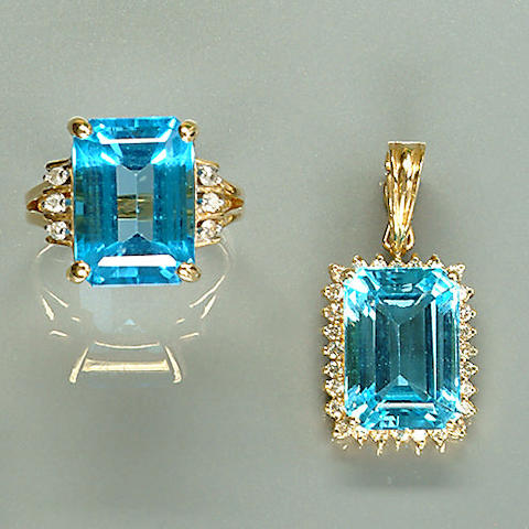 A topaz and diamond ring, earring and pendant suite