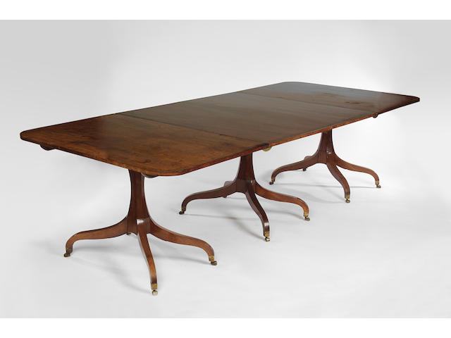 A Regency mahogany triple pedestal Dining Table,