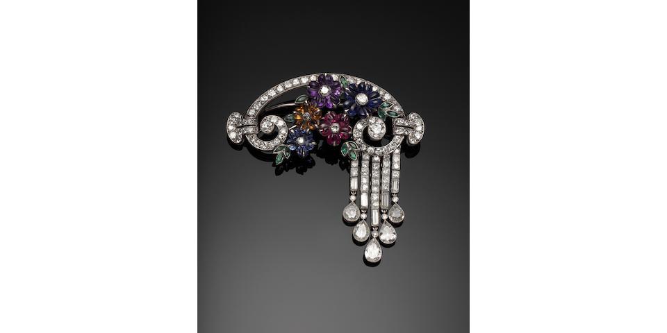 An elegant gem-set flower and diamond brooch,