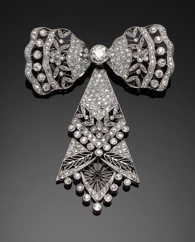 An elegent belle epoque diamond-set bow brooch