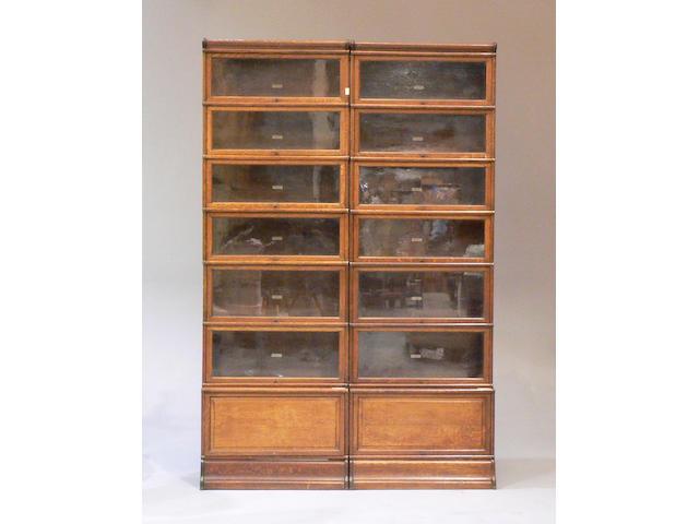 A set of three oak Globe Wernicke bookcases