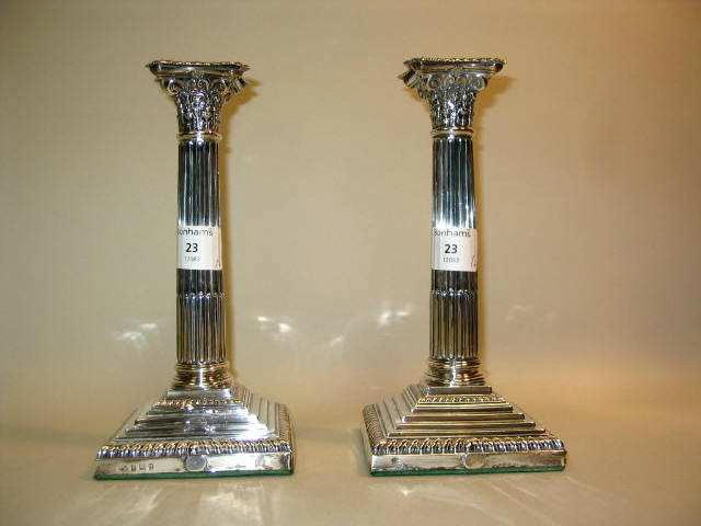 A pair of candlesticks,  by Elkington and Co,   Birmingham 1928,