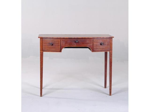 A 19th century bowfront mahogany sideboard