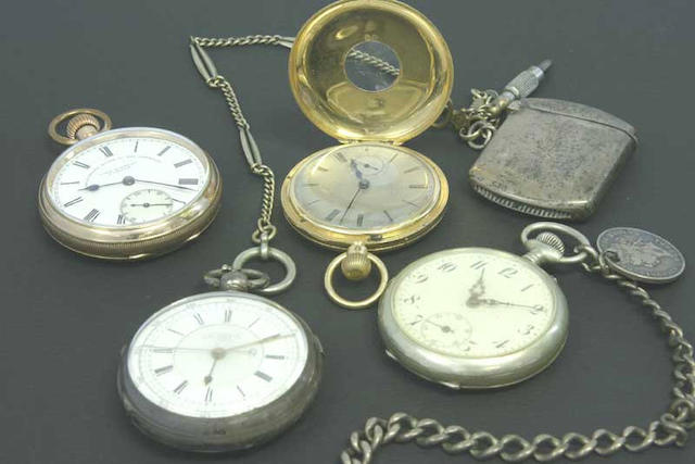 A lot of four pocket watches including an 18ct gold J.W.Benson  various ages 7