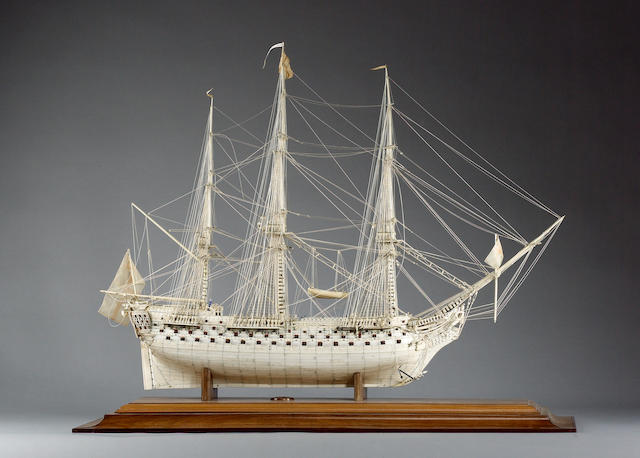 A fine and large prisoner-of-war bone ship model in case on stand