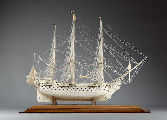 A fine and large prisoner-of-war bone ship model in case on stand