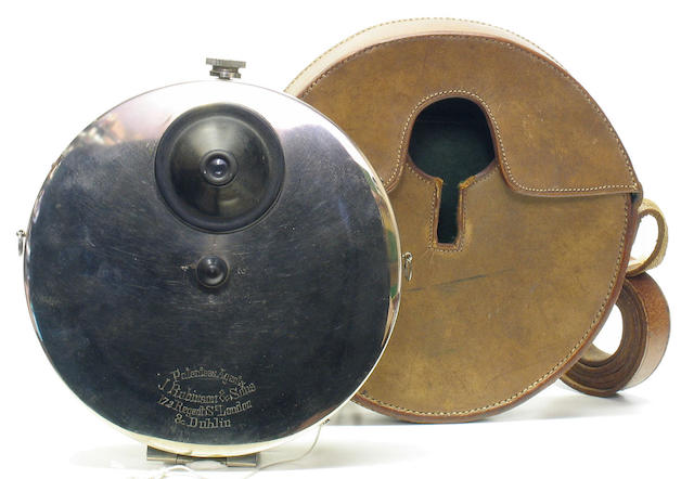 Stirn's Vest camera disc shaped concealed bright nickel plated camera.