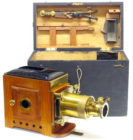 "Magic Lantern, by ""Baker 243 & 244 High Holborn London"", mahogany and brass lantern with original fitted box and lime light illuminant, telescopic tube mounted lens."