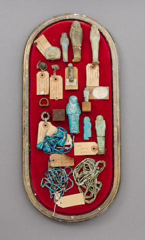 A case of shabtis, amulets, necklaces and a blue faience figure of Imsety (013, 029, 005) (3)