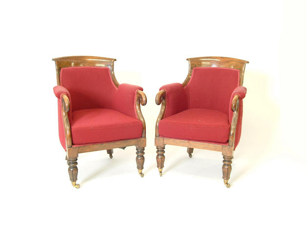 A pair of William IV simulated rosewood bergere armchairs