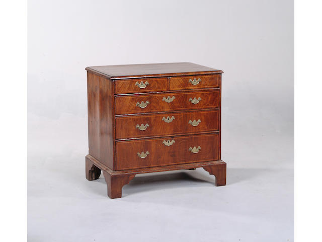 A walnut and box wood line inlaid chest of drawers