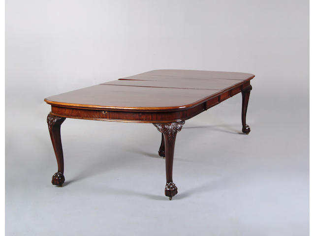 A large mahogany extending dining table