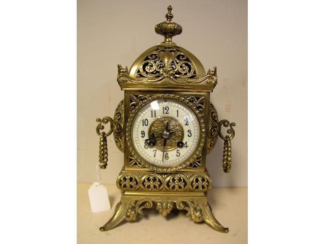 A late 19th Century French brass mantle clock