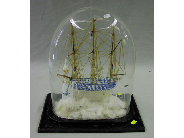 A blown glass ship diorama, 19th Century, 39 x 25 x 42cm.