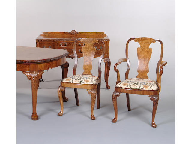 A George I style walnut dining room suite