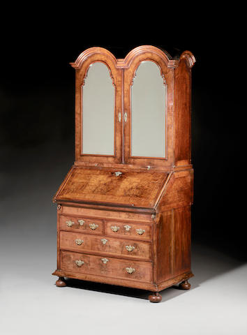 A Queen Anne walnut and featherbanded double dome Bureau Cabinet