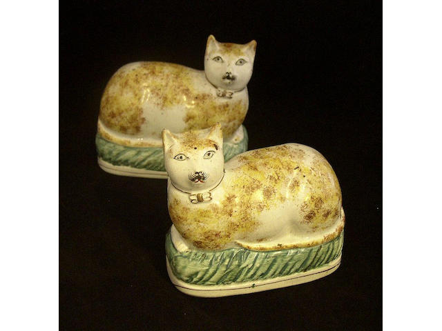 A pair of Staffordshire models of cats Late 19th Century