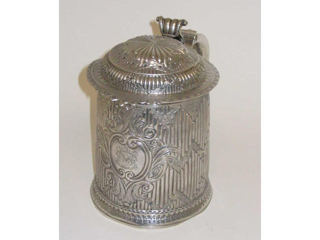 A Queen Anne tankard By John M. Stockar and Edward Peacock, 1709,