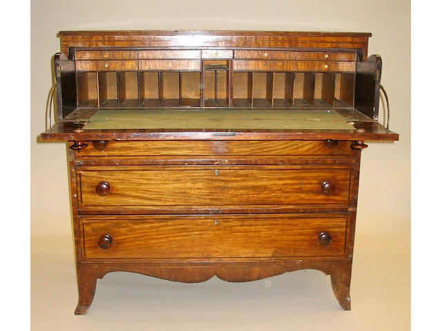 A late George III mahogany, line and dot inlaid secretaire chest