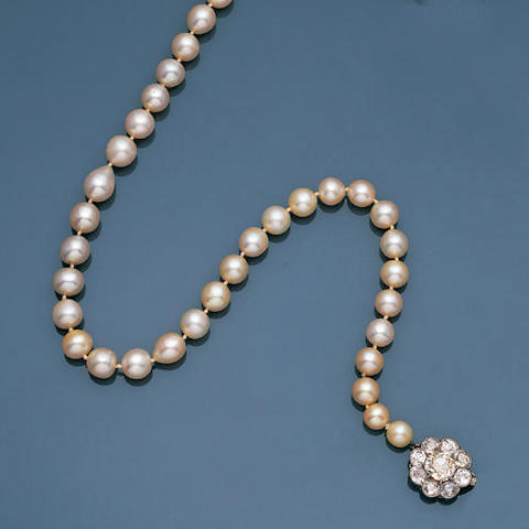An Edwardian natural pearl necklace with diamond clasp